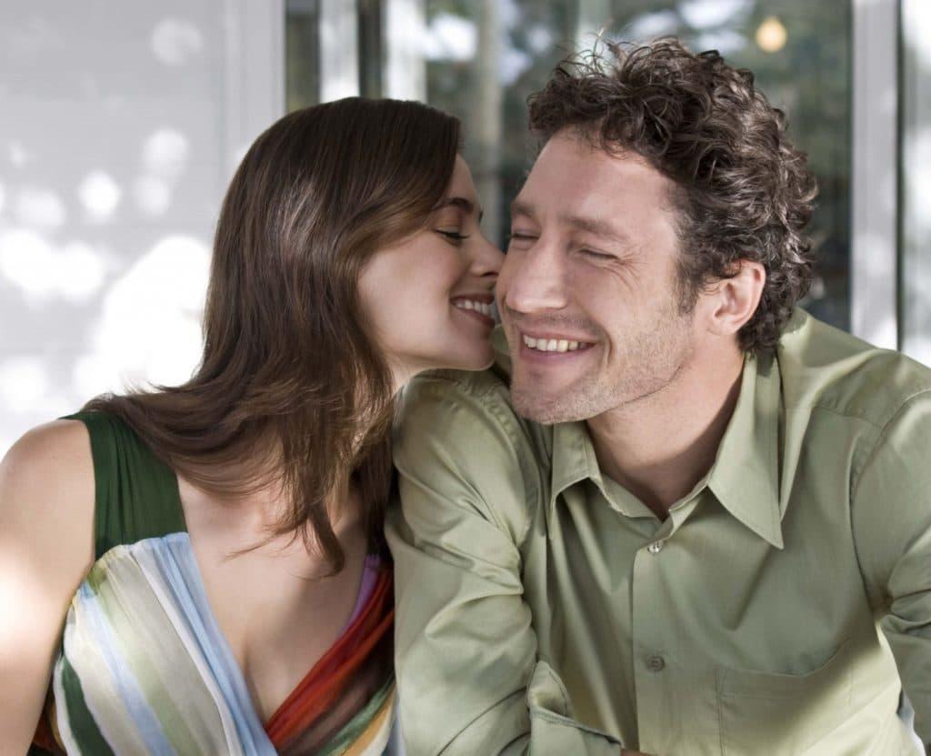 woman-whispering-man
