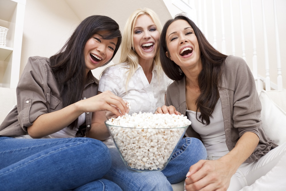 Wife watching movie with friends