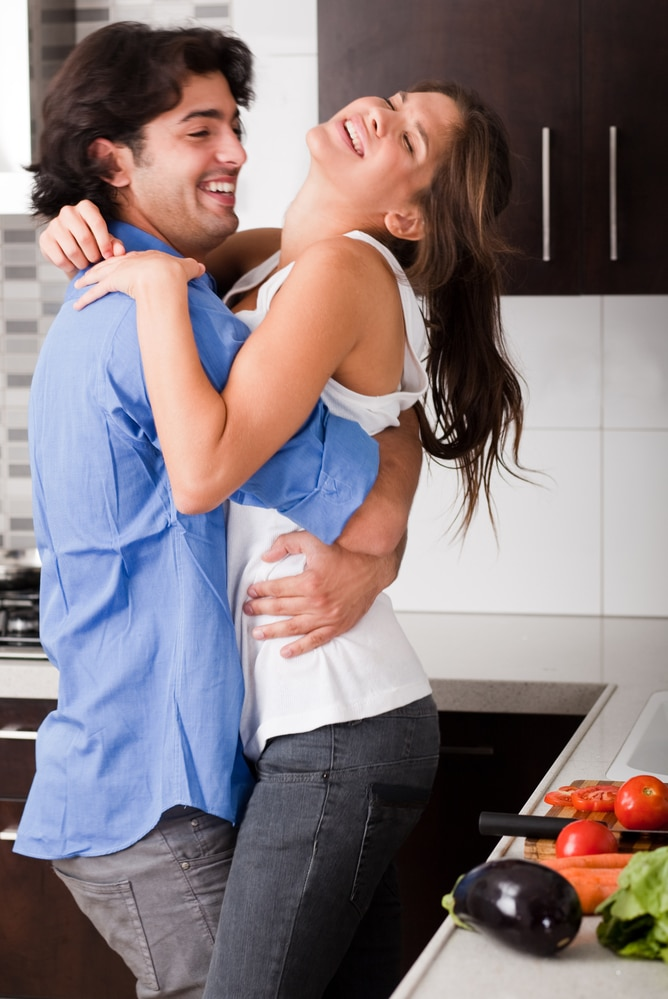 couple playful in the kitchen