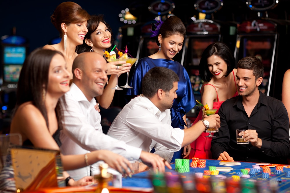 Couple playing poker with friends