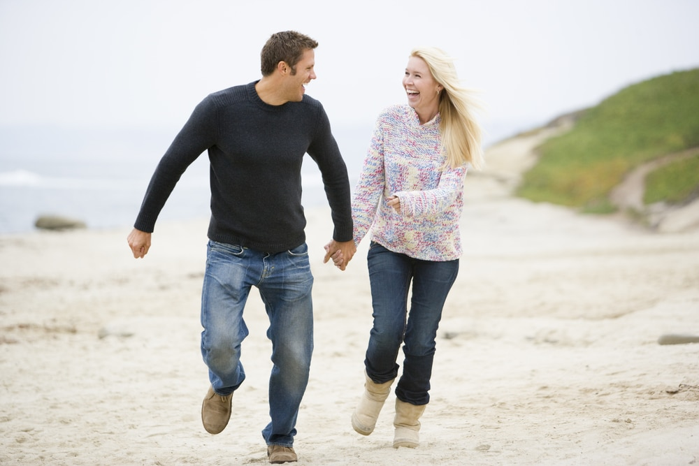 Couple walking in the beach