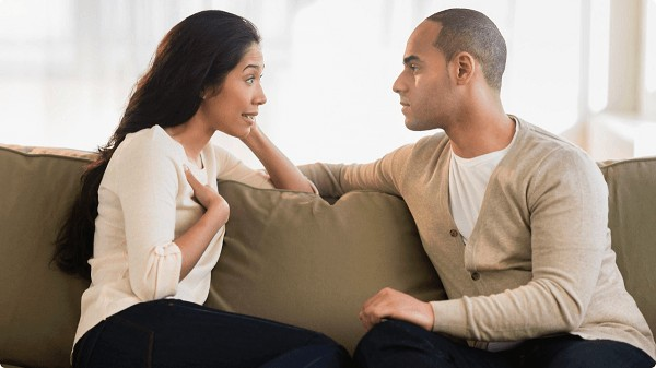 man telling a story to a woman