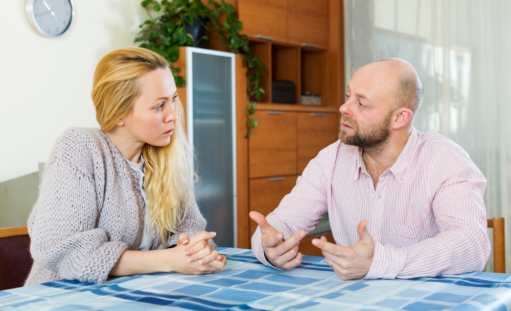 Serious couple talking