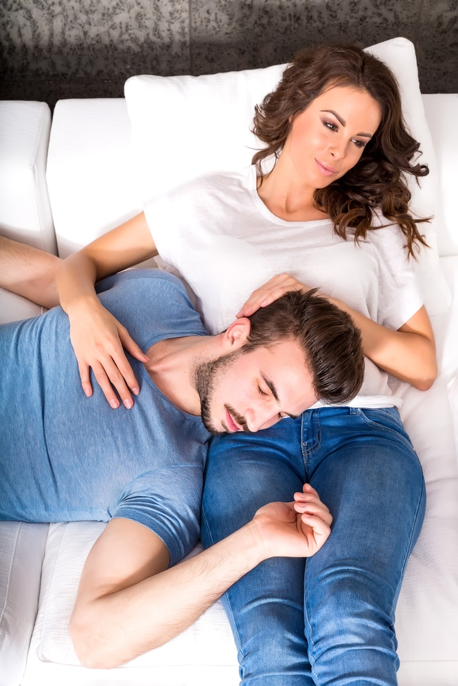 Wife cuddling husband