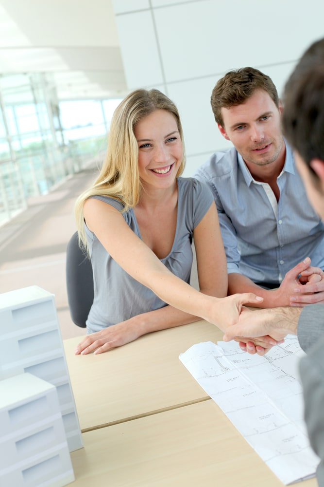 Wife shaking hands of an agent