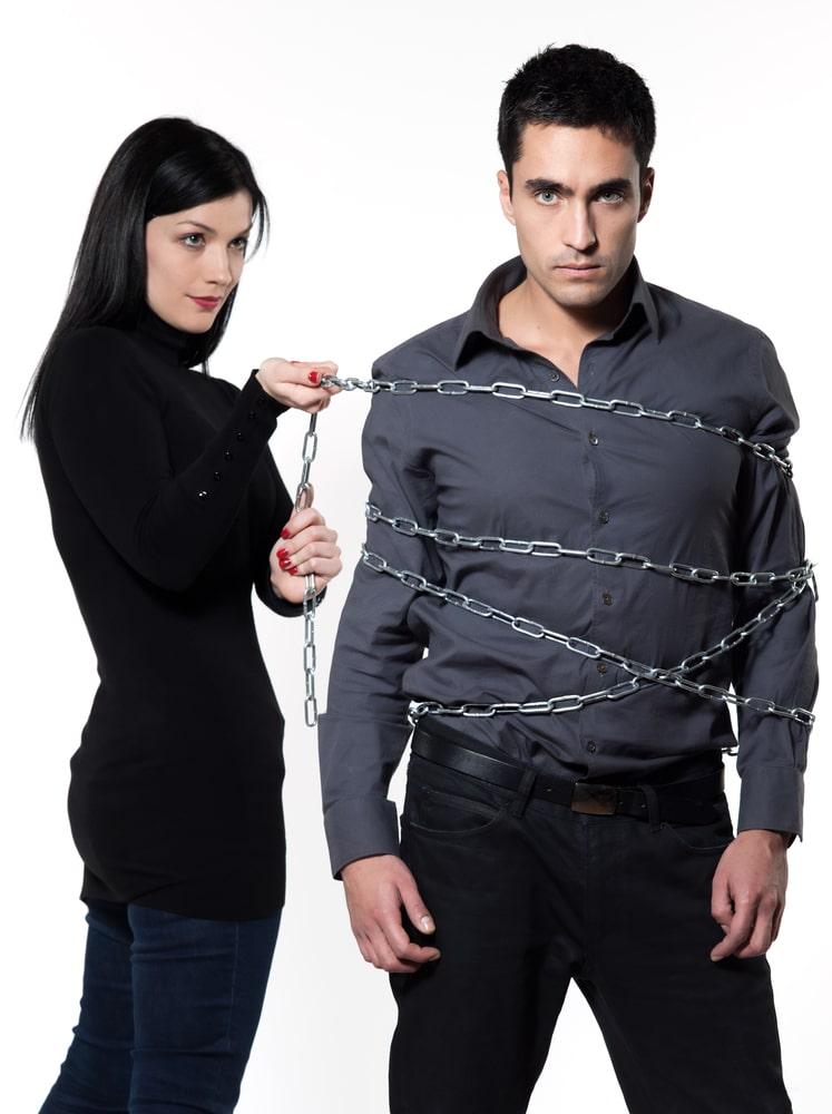Woman controlling man