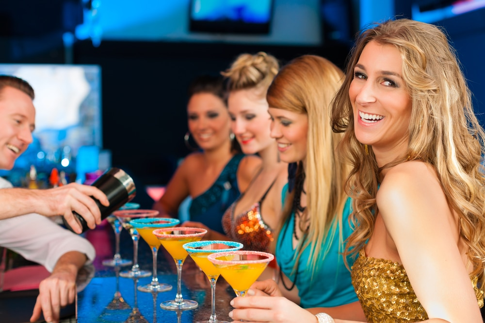Woman drinking with friends