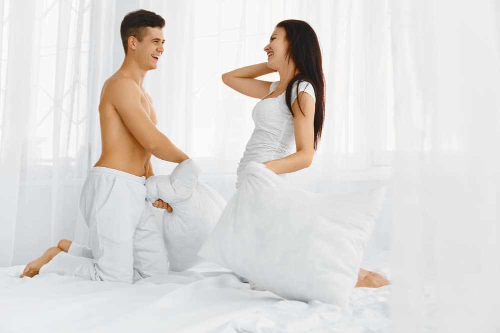 Couple playing in bed