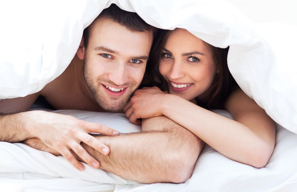 Happy couple in bed