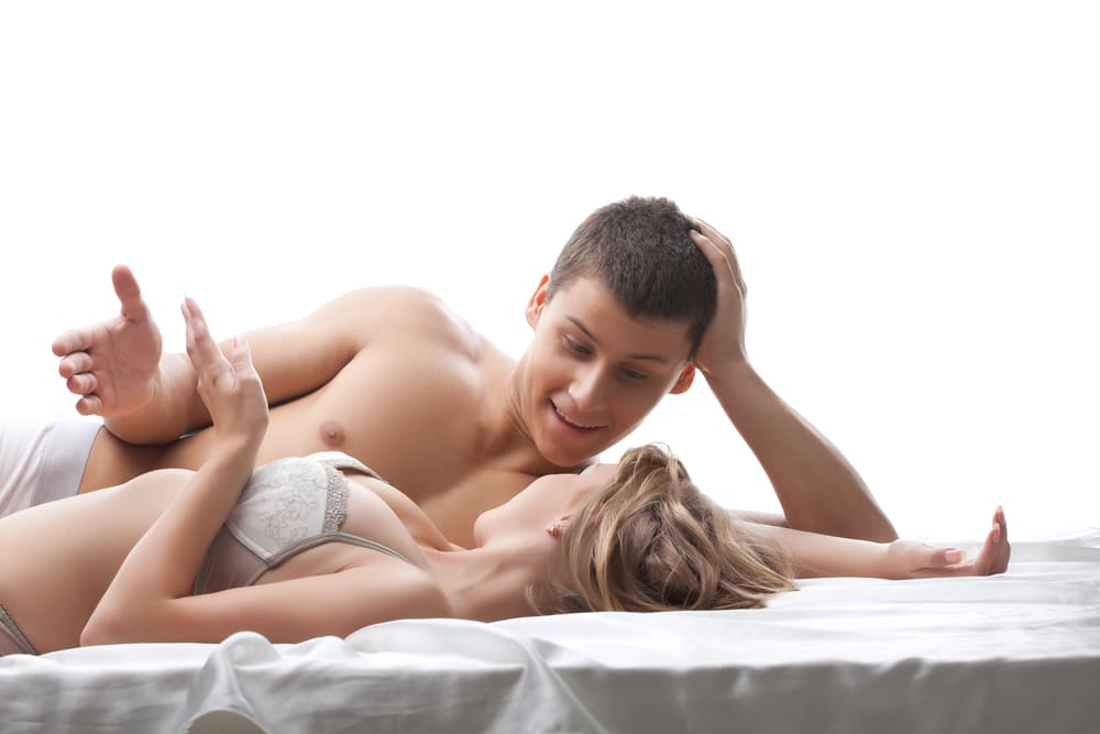 Husband talking to wife in bed